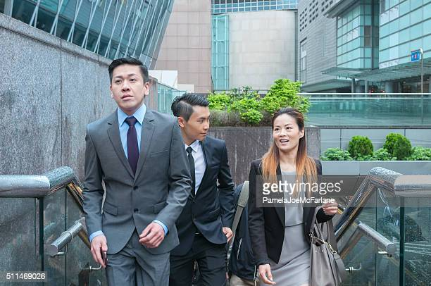 Asian Businessmen and Businesswoman Commuting and Walking up Stairs, Downtown