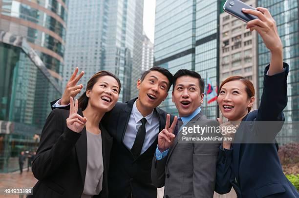 Asian Businessmen and Businesswomen Posing for a Selfie