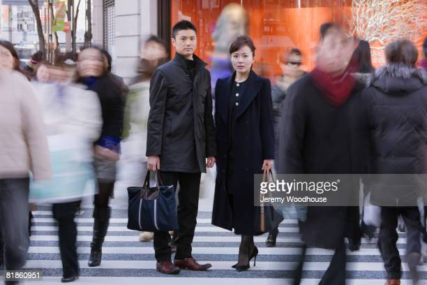 Asian businesspeople standing in crowd