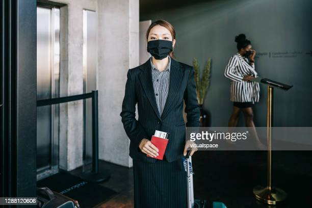 asian businesswoman at the airport - ticket stock pictures, royalty-free photos & images