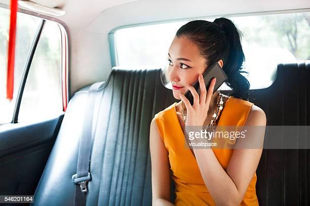 Asian Businesswoman Calling Her Business Partner To Meet Her