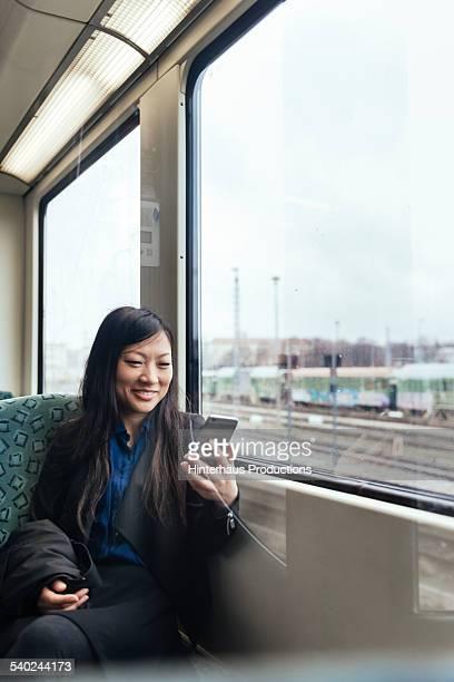 Asian Businesswoman Commuting In Train