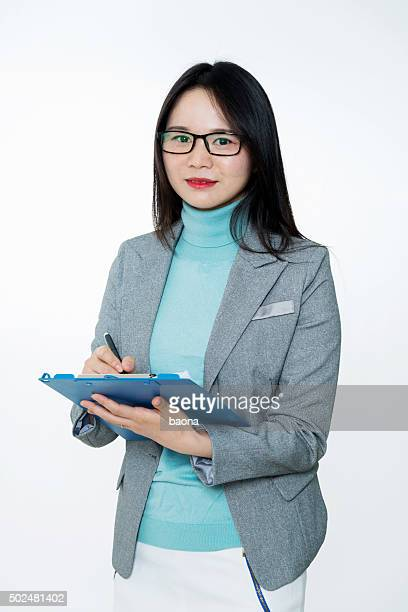 Asian businesswoman holding files