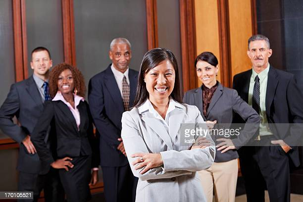 Asian businesswoman in boardroom with colleagues