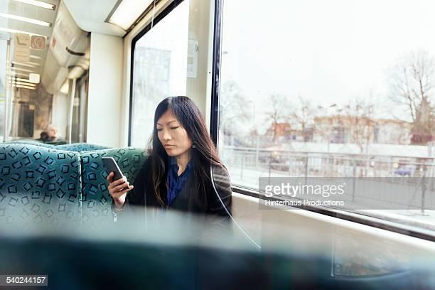 Asian Businesswoman In Commuter Train