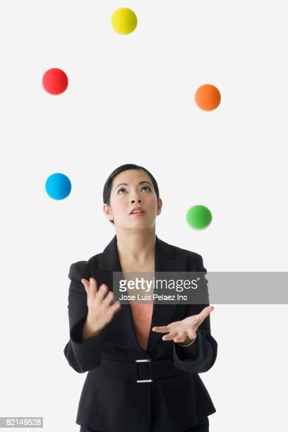 Asian businesswoman juggling