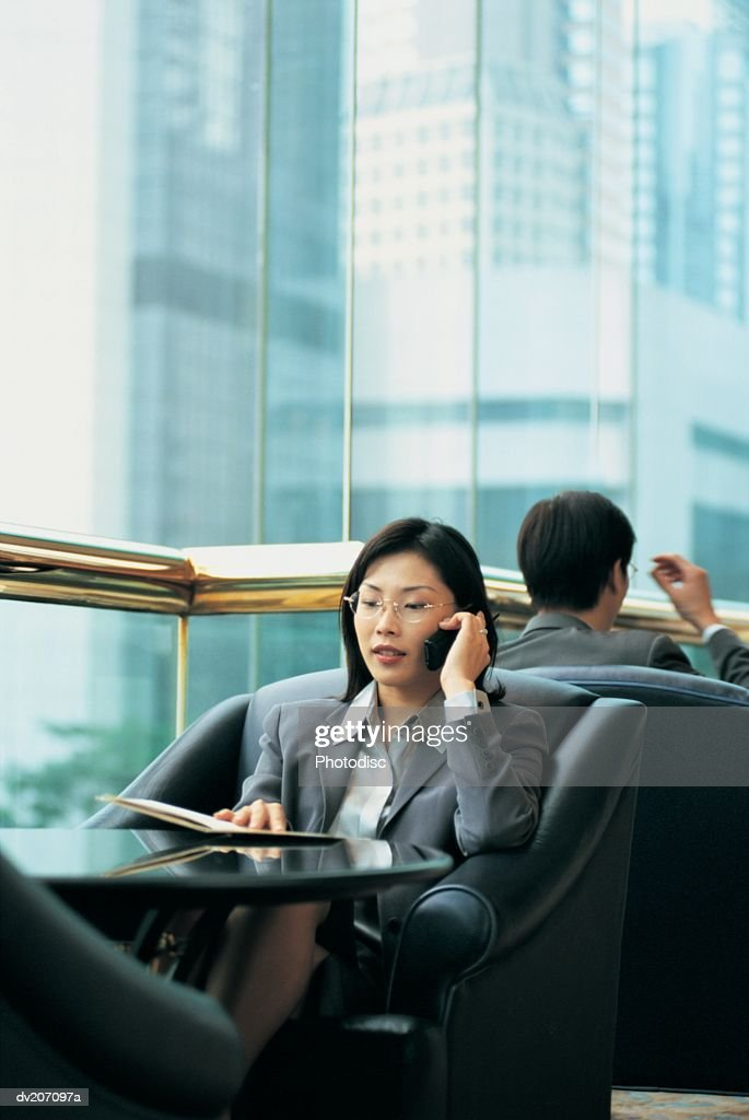 Asian businesswoman on cell phone : Stock Photo