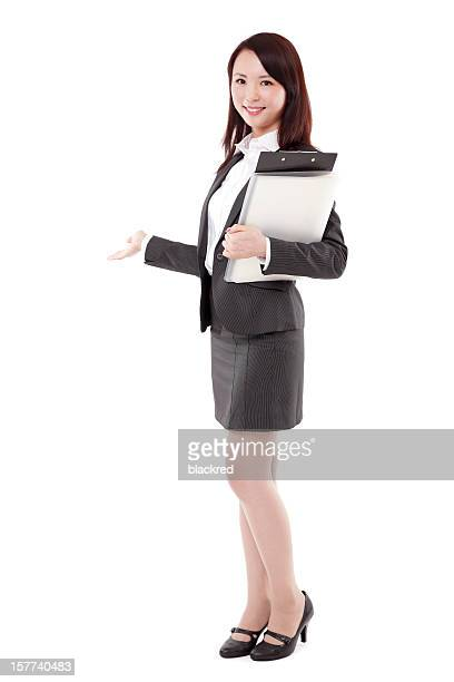 Asian Businesswoman Presenting Holding Folders on White Background