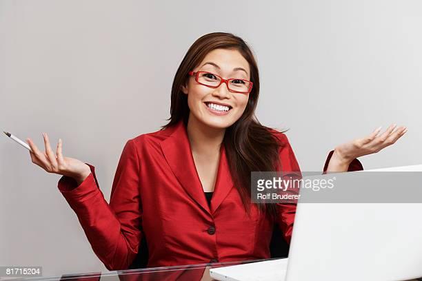 Asian businesswoman shrugging shoulders