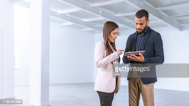asian businesswoman talking to interior designer in an empty office - condition stock pictures, royalty-free photos & images