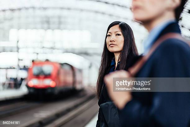 Asian Businesswoman Waiting For Her Train