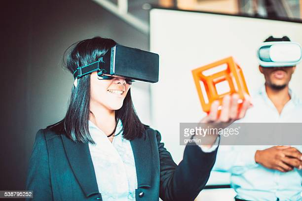 Asian businesswoman with virtual reality goggles