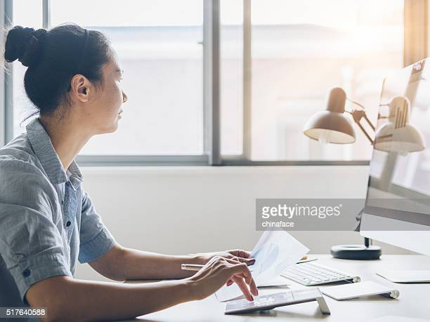 asian businesswoman working at home