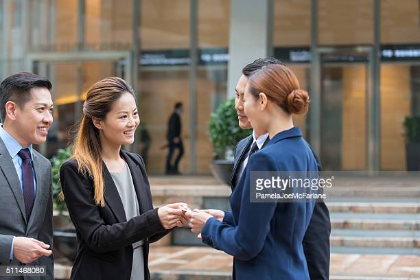 Asian Businesswomen and Businessmen Exchanging Business Cards, Hong Kong, China