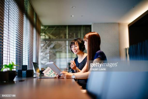 Asian busineswomen at work in banking or financial company