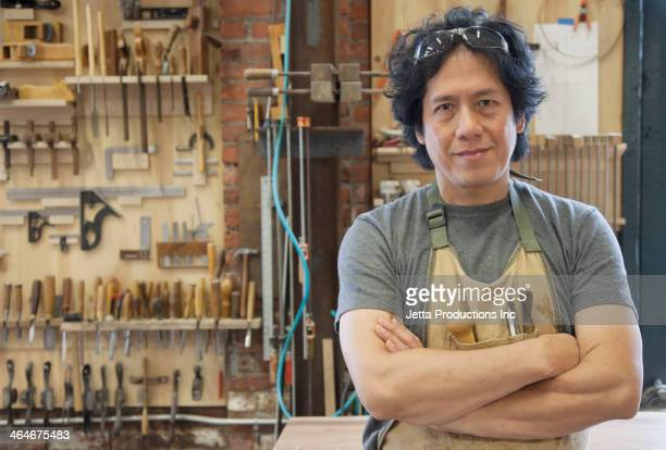 Asian carpenter in workshop