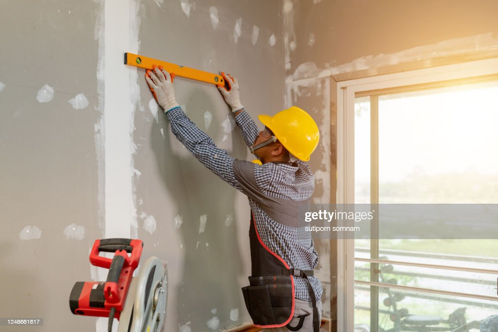 Asian carpenter is working to install interior furniture. : Stock Photo