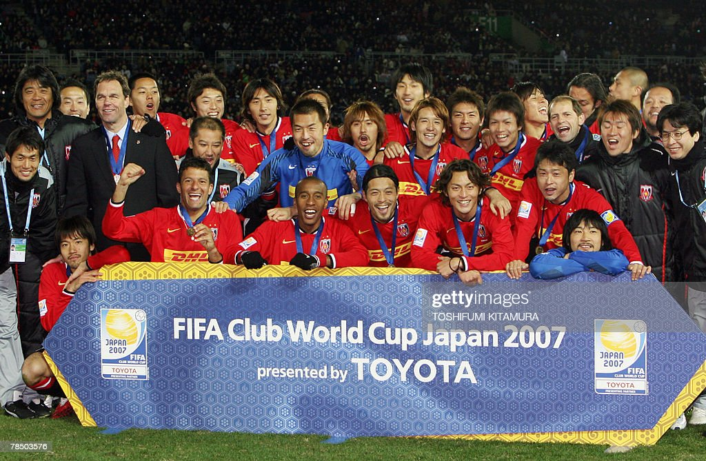 Asian champions Urawa Reds players celebrate during the awarding ceremony after beating African champions Etoile Sahel in their Club World Cup Japan 2007 play-off match for the third place in Yokohama, 16 December 2007. Urawa beat Sahel by 2-2 (4-2) to clinch the third place.