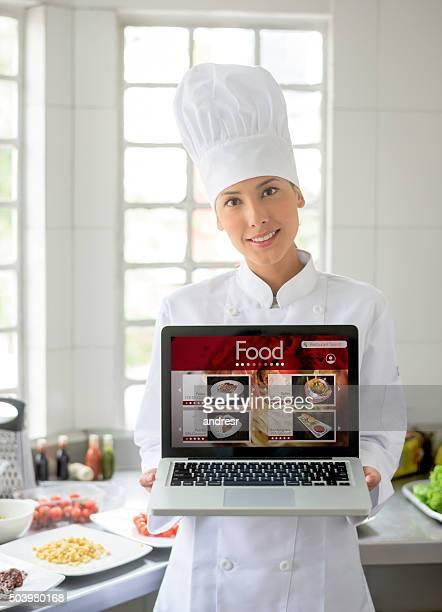 Asian chef holding an online menu