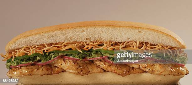 asian chicken sub sandwich - grinder sandwich stock pictures, royalty-free photos & images