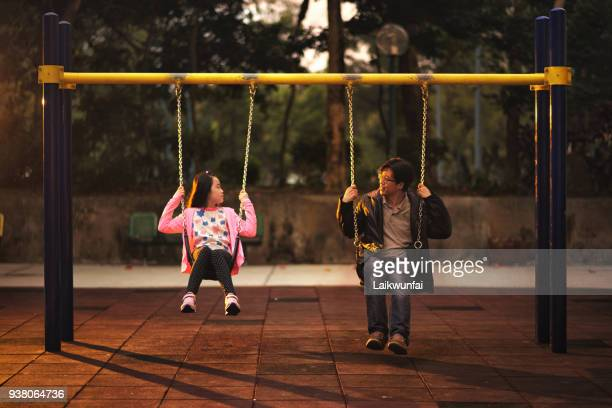 asian child and father sitting on swing - korean teen stock pictures, royalty-free photos & images