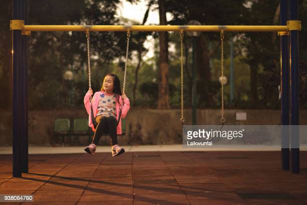 asian child sitting alone on swing - korean teen stock pictures, royalty-free photos & images