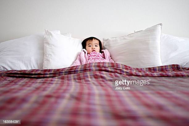 asian child sleeping in a large bed - las vegas girls stock photos and pictures