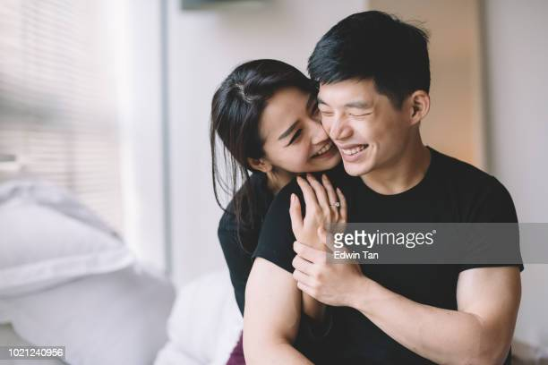 asian chinese couple hugging and bonding time - asian stock pictures, royalty-free photos & images