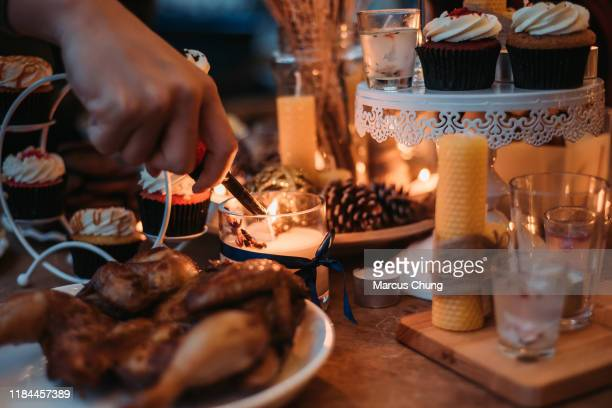 asian chinese doing preparation and light up the candle before christmas party begin at roof top of house - christmas decore candle stock pictures, royalty-free photos & images