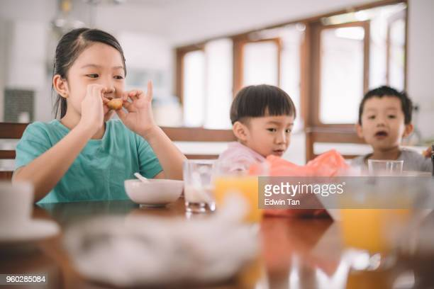 asian chinese family at dining room having breakfast