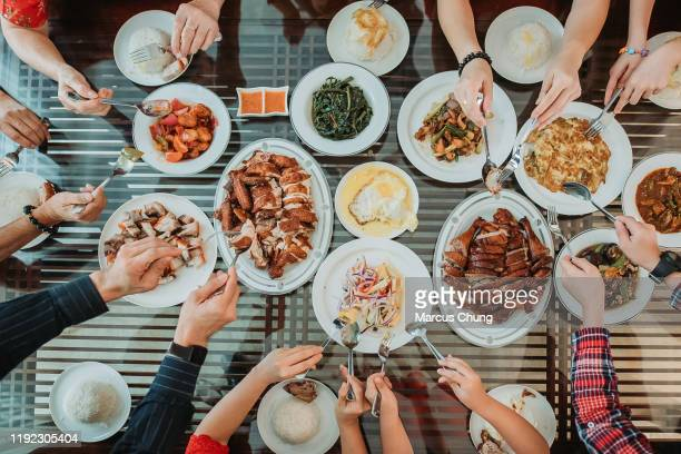 asian chinese family enjoy their home made food during chinese new year's eve reunion dinner - thanksgiving food stock pictures, royalty-free photos & images