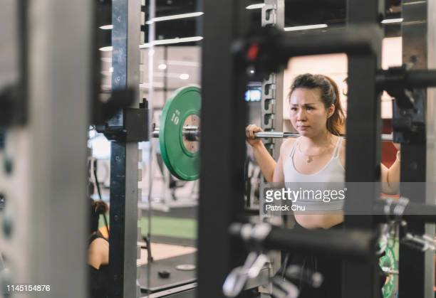 asian chinese female barbell workout exercise at gym - women's weightlifting stock pictures, royalty-free photos & images