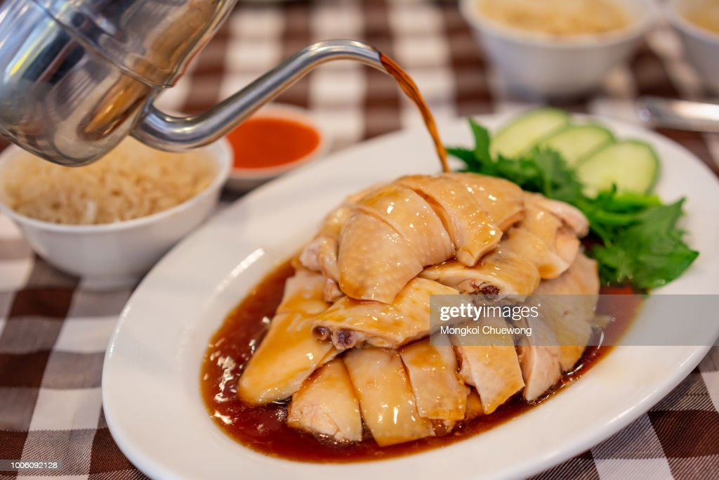 Asian Chinese food style Steam Chicken with Rice and sauce (Hainan Chicken) on white plate at Chinese restaurant in Singapore : Stock Photo