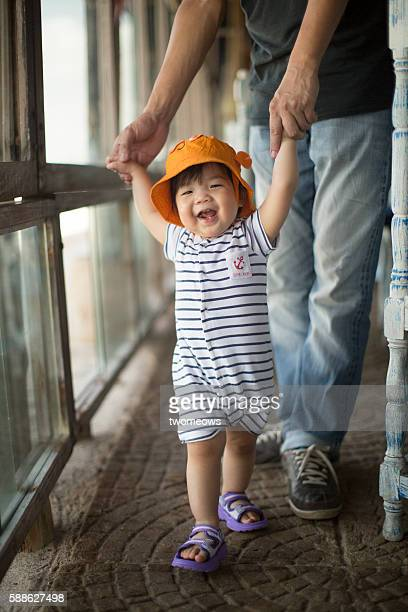 Asian Chinese toddler learn to walk.