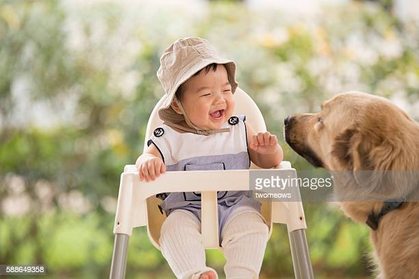 Asian Chinese toddler with dog.