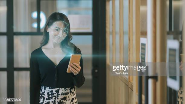 asian chinese turn on smart phone for face recognition system and access to internet - graphical user interface stock pictures, royalty-free photos & images