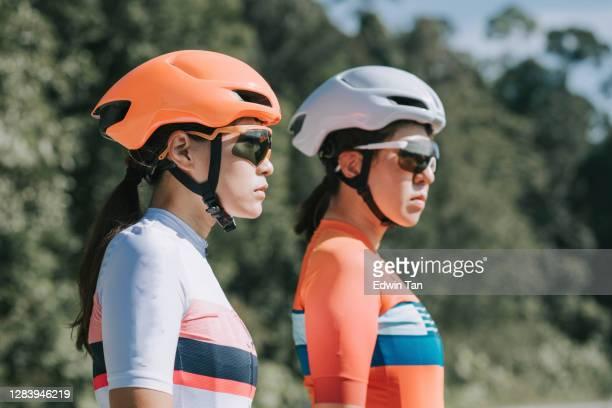2 Asian chinese women road bike cyclist portrait