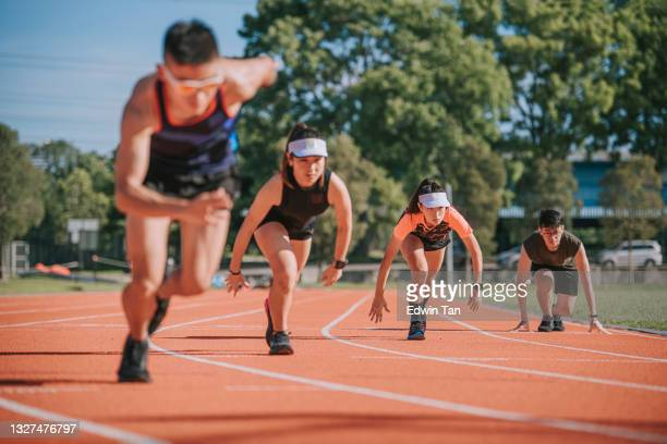 asian chinese young athletes sprint running at track and run towards finishing line in the morning at track and field stadium - forward athlete stock pictures, royalty-free photos & images