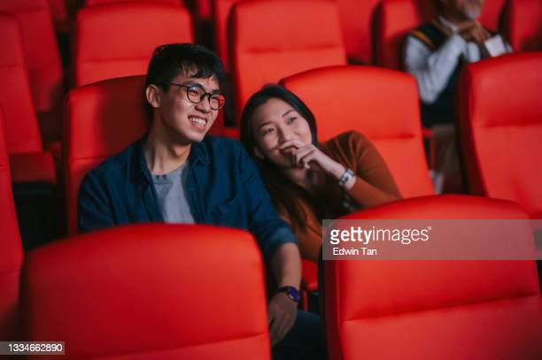 asian chinese young couple enjoy watching movie show in cinema bonding time - film premiere stock pictures, royalty-free photos & images