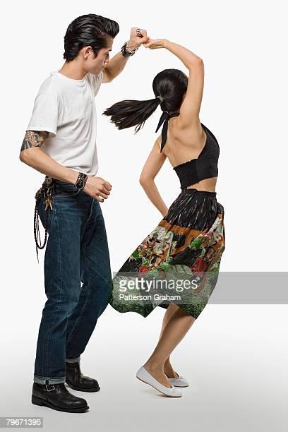 asian couple dancing - rockabilly photos et images de collection