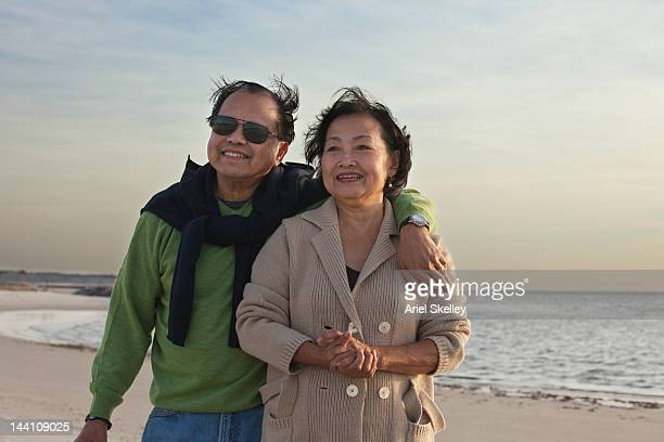 Asian couple enjoying the beach