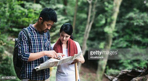 Asian Couple Exploring the Map