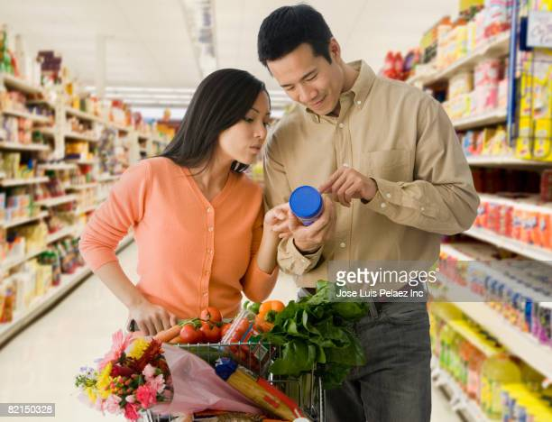 Asian couple grocery shopping