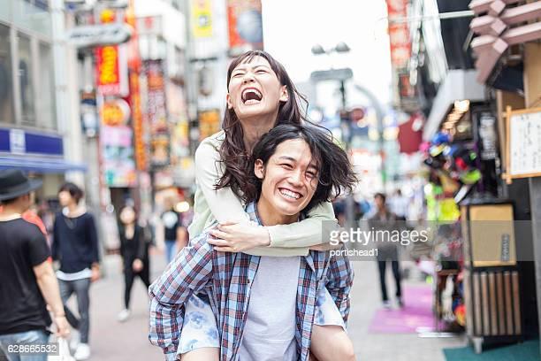 Asian couple having fun on street