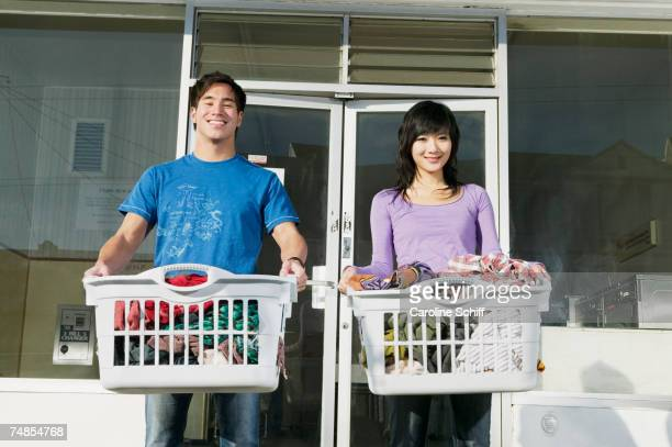 Asian couple in front of Laundromat