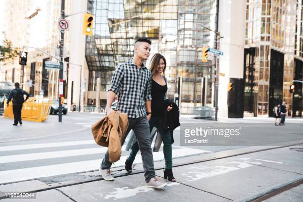 asian couple in toronto city street - downtown stock pictures, royalty-free photos & images