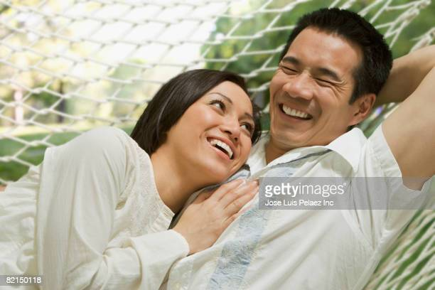 asian couple laying in hammock - vietnamese ethnicity stock pictures, royalty-free photos & images