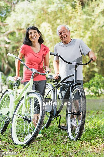 Asian couple riding bicycles