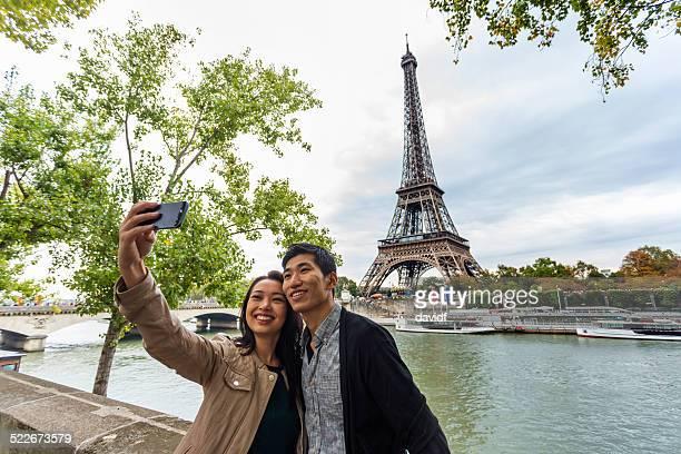 Asian Couple Selfie Self Portrait At Eiffel Tower Paris
