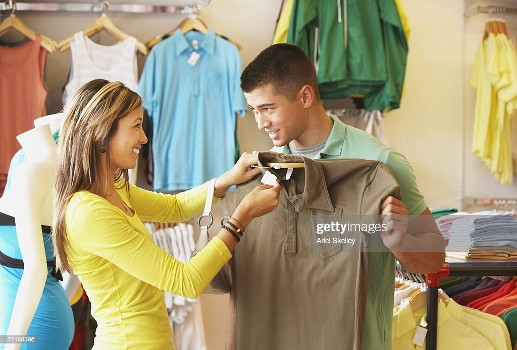 Asian couple shopping for clothing : Stock Photo